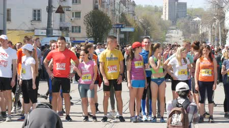 squats : April 21, 2018 - Kamenka, Ukraine: crowd of people participating in the marathon waiting for start command