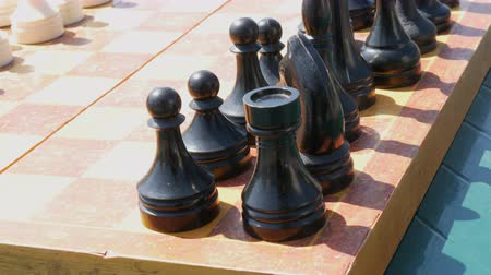 storming : Black and white chess stand on the board, on street