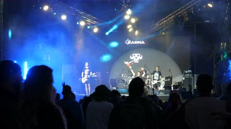 akord : June 1, 2018 - Svidivok village, Ukraine: Tarasova Gora Moto Festival, the guitarist plays a rock concert on an electric guitar and singer sings Dostupné videozáznamy