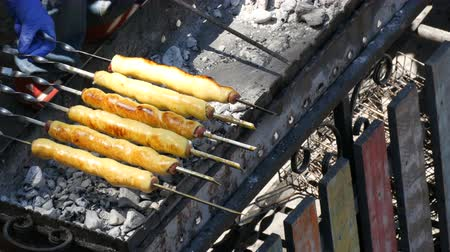 calabresa : The sausage in the dough is roasted on grilled skewer, fast food, street food Stock Footage