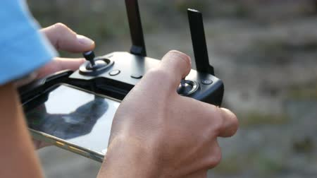 markolat : Remote control from quadrocopter or drone operated by a mans hands close up view