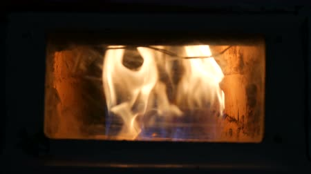 şömine : Vintage old gas fireplace in which fire burning close up view Stok Video
