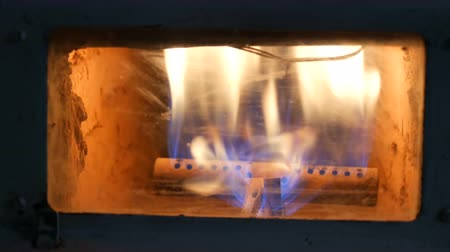 cova : Vintage old gas fireplace in which fire burning close up view Stock Footage