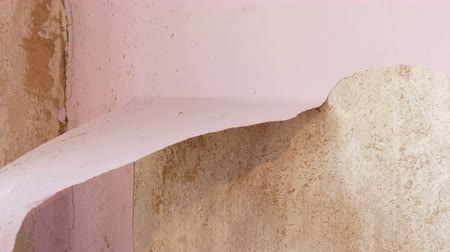 wall building feature : Home repairs. The male hand peels off the pink old wallpaper from the walls with special spatula