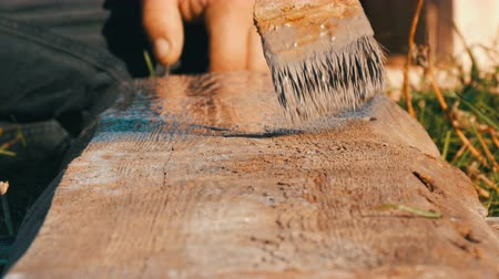polished : Wood painting with a brush with gray color