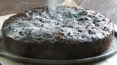 fondán : Very big chocolate brownie cake powder on top with white icing sugar