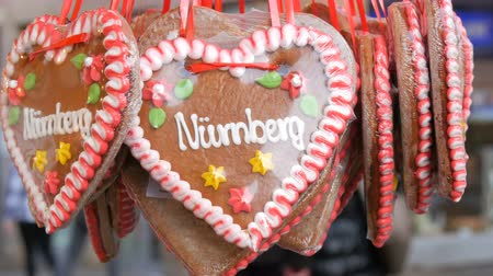 powdered : Traditional German Christmas multicolored painted gingerbread with the multicolored flowers and the inscription Nuremberg Stock Footage
