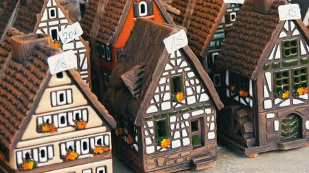 Beautiful candlesticks in form of houses in the style of fachwerk. National German and Dutch white with black beams mini houses on the Christmas market in Nuremberg