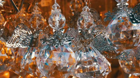 húr : Beautiful Christmas tree toy in the form of a crystal angel sways in the wind. New Years and Christmas decor