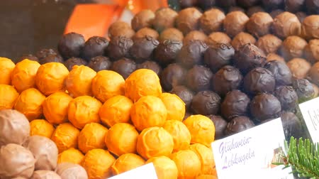 засахаренный : Sweet Chocolate and various chocolates candies sold in Christmas market Стоковые видеозаписи