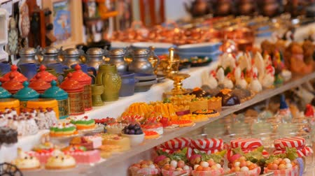 trombita : Female hand chooses decorative Christmas and New Year trifles on the counter of Christmas market Stock mozgókép