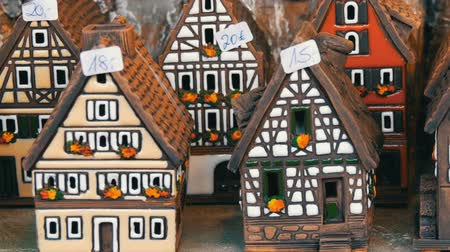 titular : Beautiful candlesticks in form of houses in the style of fachwerk. National German and Dutch white with black beams mini houses on the Christmas market in Nuremberg