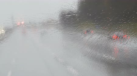 münih : Close-up shot of rain drops and streaks on the window od moving bus by highway in deep autumn Stok Video