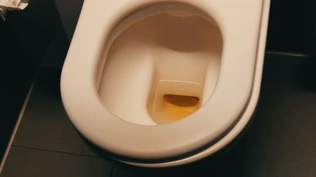 clogged : Dirty ceramic toilet bowl in a public restroom. Stock Footage