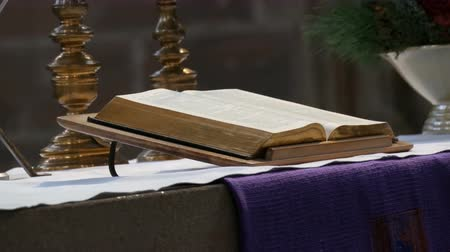 czarodziej : The great book of the priest lies on the altar in the old catholic church