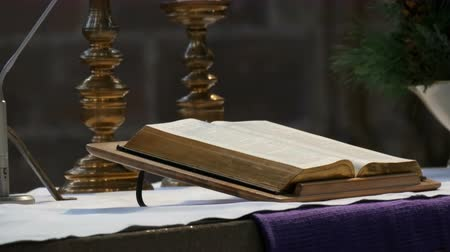 peregrino : The great book of the priest lies on the altar in the old catholic church