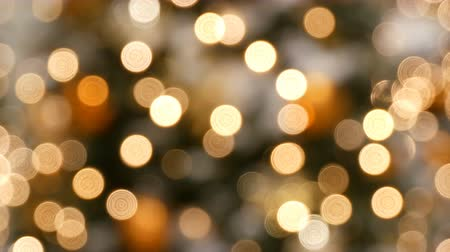 festoon : Blurred lights of Christmas garlands in golden silver and white color