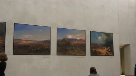műalkotás : Munich, Germany - December 2, 2018: New Pinakothek, world famous Picture Gallery in Munich, Germany. A view from inside on the famous paintings and people looking at them in Art Gallery.
