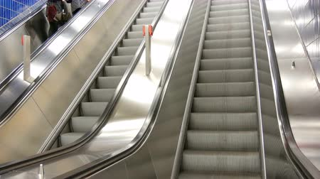 asansör : Large modern staircase escalator rides the subway up