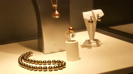 east pearl : Counter with expensive luxury jewelry made of gold, silver, pearls in the window of jewelry store
