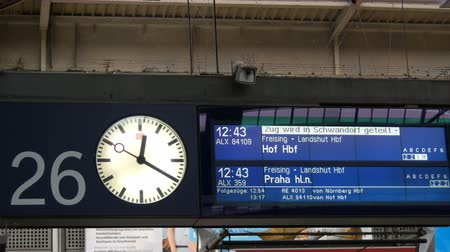 münih : Munich, Germany - December 2, 2018: The electronic board of arriving and departing trains is written in German. Round the clock station at the main railway station in Munich.