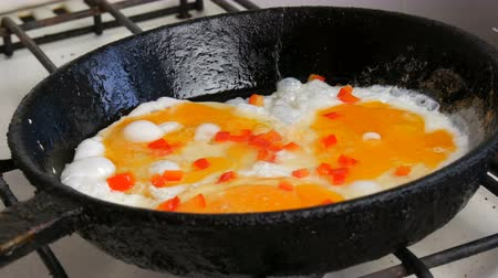 křaplavý : Fried eggs in pan with sweet pepper paprika. Morning breakfast