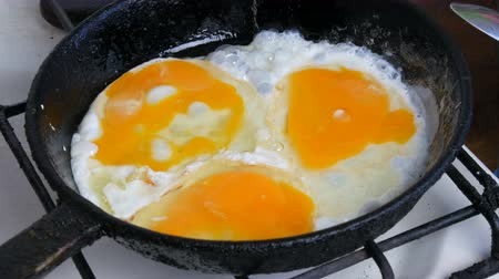 Fried eggs in pan. Morning breakfast