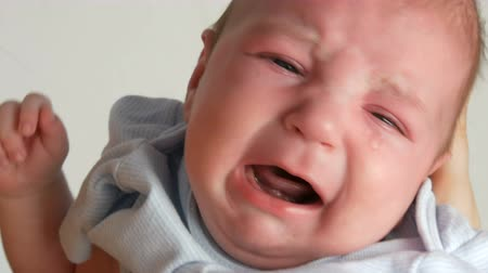 Two month old newborn baby cries loudly. Child face close up view Dostupné videozáznamy