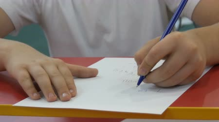 liste : Boy teenager learns to write with left hand
