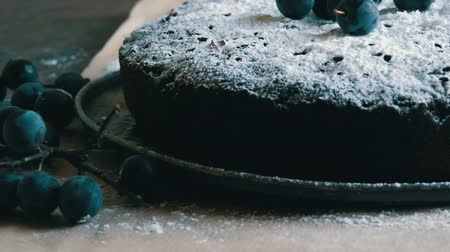 šlehačka : Chocolate cake brownie generously covered with powdered sugar stylishly lying next to the blue berries