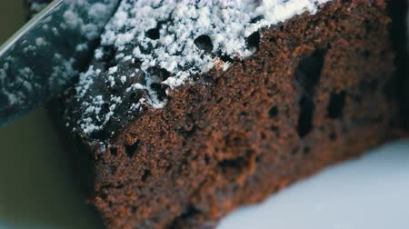 muffin : Knife cuts a chocolate brownie cake dough close-up macro view Stock Footage