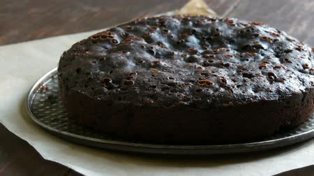 домовой : Very big chocolate brownie cake powder on top with white icing sugar