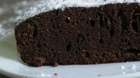 cuisine dark : Freshly baked chocolate brownie pie in cut close-up macro view