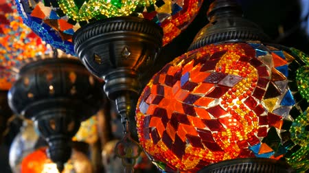 ramadan bazaar : Many multi-colored Turkish mosaic lamps on ceiling market in the famous Grand Bazaar in Istanbul, Turkey Stock Footage