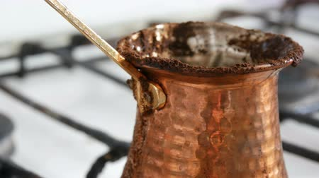 kaynatmak : Boiled away runaway ground black coffee in a copper turk on white gas stove