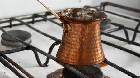 turk : Boiled away runaway ground black coffee in a copper turk on white gas stove