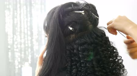 ヘッドドレス : Hairdresser stylist makes a special curl small curly hair with special curling iron 動画素材