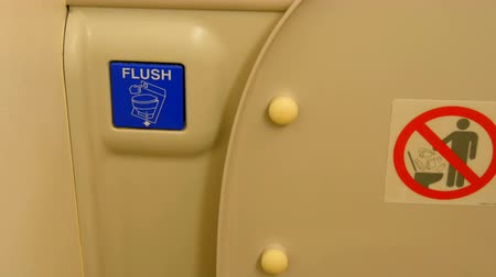 aircraft cabin : Old toilet cabin on plane. Toilet and flush button. Interior of toilet room in the modern aircraft Stock Footage