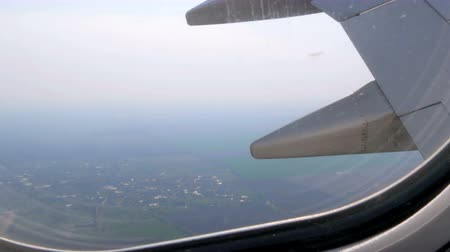 aircraft cabin : The plane flies over the fields of Europe, the wing of the plane in porthole