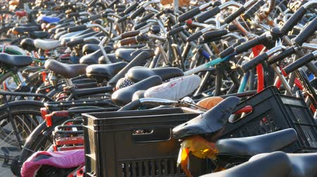 アムステルダム : Amsterdam, Netherlands - April 21, 2019: Parking for bicycles. Many different bicycles parked on a street in special parking lots. The problem of bicycle overload in the country 動画素材