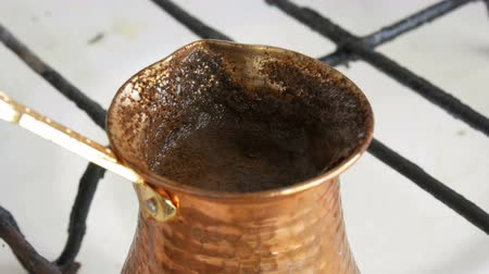 やかん : Boiled away runaway ground black coffee in a copper turk on white gas stove
