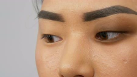 bizakodó : Eyes korean asian close up Stock mozgókép