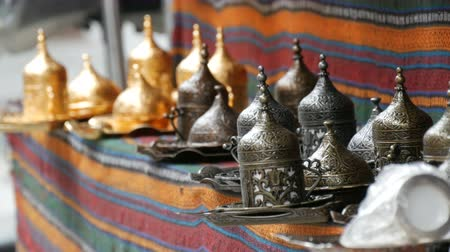 relics : Copper tea set in various colors of a gold and gray. Turkish market counter Stock Footage
