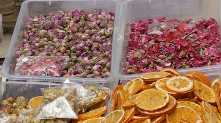 botanikus : Dried flowers on a counter. Dried slices of orange and rosebuds. Shop for lovers of needlework. Handmade
