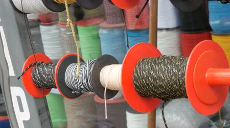 hawser : Strong ropes of different colors are wound on special reels on the counter in store Stock Footage