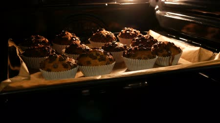 muffin : Delicious muffins in paper molds are cooked in oven