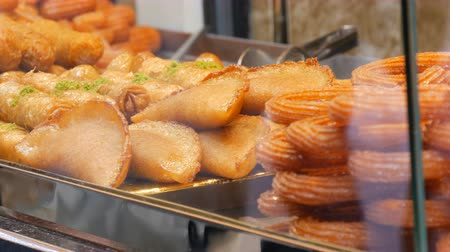 bread pan : Variety of greasy pastries on the counter of a street shop. Fast Food, Street Junk Food