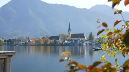 bavorské : A boat ferryman ferries people to the other side, in the background of beautiful, picturesque church on Lake Tegernsee, Bavaria, Germany Dostupné videozáznamy