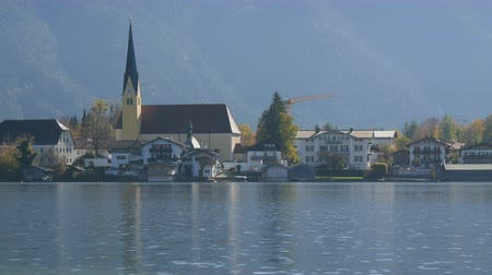 bavorské : Beautiful old church in vibrant place on the background of the Bavarian Alps on the shore of Lake Tegernsee