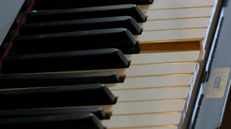 dizgi : Close up view of mystical self-playing piano without pianist. The piano themselves play. Halloween concept.